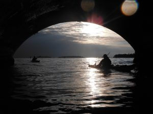 Two kayaks under a bridge in the afternoon (press photo)